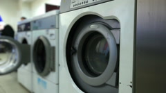 Washing machines in laundry room, close-up Stock Footage