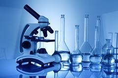 Science concept, Chemical laboratory glassware, microscope Stock Photos