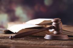 Stock Photo of Law theme, mallet of judge, wooden gavel, books, justice scale