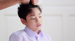 Unidentified woman hairdryer drying hair asian boy, beauty and fashion Stock Footage