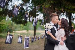 Bride and Groom at wedding Day walking in summer park Stock Photos
