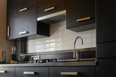Contemporary modern fully fitted kitchen in brown with top spec appliances Kuvituskuvat