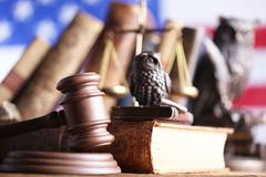 Law theme, mallet of judge, wooden gavel, books, justice scale Stock Photos