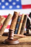 Law theme, mallet of judge, wooden gavel, books, justice scale - stock photo