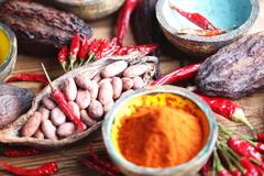 cacao beans and chili peppers - stock photo
