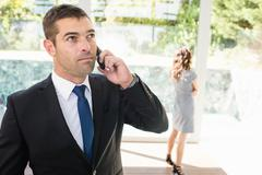 Real-estate agent talking on the mobile phone - stock photo