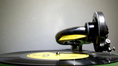 Old gramophone playing a yellow plate - stock footage