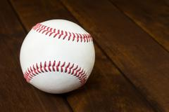 Baseball Ball on wooden board Stock Photos