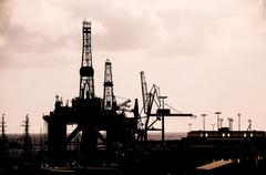 Oil Drilling Rig Silhouette - stock photo
