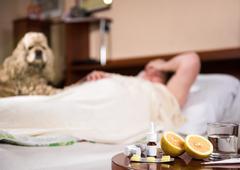 Sick woman lying at bed Stock Photos