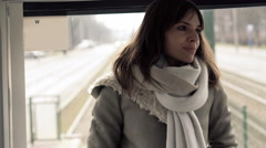 Young woman during tram ride Stock Footage