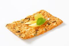 Pumpkin seed cheddar cracker - stock photo