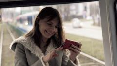 Happy woman watching movie one smartphone during tram ride Stock Footage