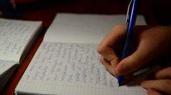 Boy writes in notebook homework on Russian language Stock Footage