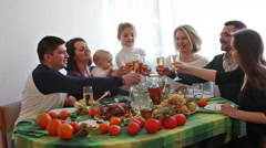 Multigenerational family sitting at holiday table Stock Footage