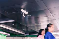Security IR camera for monitor events in city. Stock Photos