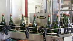 Sparkling bottles on the conveyor belt in a factory Stock Footage