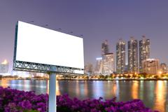 Blank billboard for advertising with night cityscape background. Kuvituskuvat