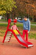 Father and son having fun at the slide Stock Photos