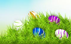 Easter eggs on a green hill Stock Illustration