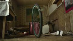 Abandoned home. Bicycle wheel and falling stuff - stock footage