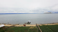 Lake Titicaca with boat Stock Footage