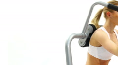 Beautiful blonde training on exerciser close-up Stock Footage