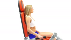 Attractive blonde exercising on trainer Stock Footage