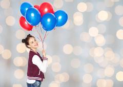 happy teenage girl with helium balloons - stock photo