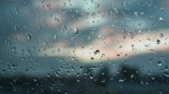 Raindrops on a window. Outside, the view of the city. Melancholy.  - stock footage