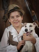 Little hunter with a dog - stock photo
