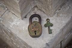 Ancient Indian key lock, green with age - stock photo