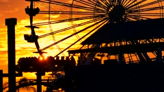 Footage Silhouette Ferris Wheel Santa Monica Pier Sunset Dramatic Sky Clouds - stock footage