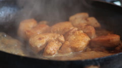Pieces of chicken fried in the pan close-up Stock Footage