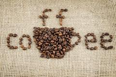 Coffee beans on sackcloth Kuvituskuvat