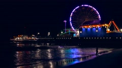 Illuminated Santa Monica Pier Night Purple Ferris Wheel Water Beach Nature - stock footage
