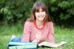 Young Female Student Studying In Park - stock photo