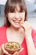 Young Woman Eating Bowl Of Healthy Seeds Stock Photos