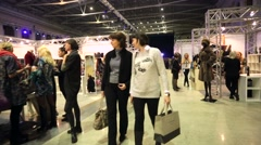 People visit designers boutiques inside Gostiny Dvor during Moscow Fashion Week. - stock footage