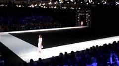 Models walk on the Valentin Yudashkin catwalk. - stock footage