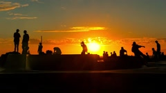 Silhouette Tourists Sunset Skateboarding Extreme Skatepark Enjoyment Orange Stock Footage