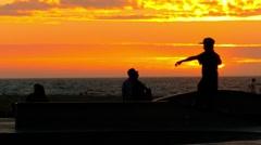 Stock Video Footage of Extreme Skatepark Sunset Tourists Skateboarding Vitality Enjoyment Orange Youth