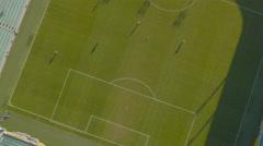 4K Aerial: Players Kicks Ball Around at Soccer Stadium - stock footage