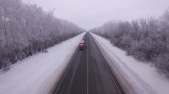 Aerial photography Winter straight road between the cities. Trucks and cars. - stock footage