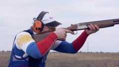 shooter with a gun takes aim Slow Motion - stock footage