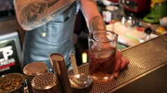 Bartender prepares cocktail at Mr. Help & Friends bar. Stock Footage