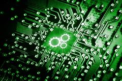 Gears icon on computer chip - stock photo