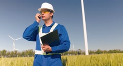 Stock Video Footage of Supervisor Talking Walkie-Talkie Working Agriculture Windmill Communication