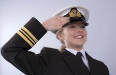 Portrait of a young female naval officer - stock photo