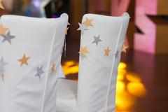 Chairs decorated in a banquet hall Stock Photos